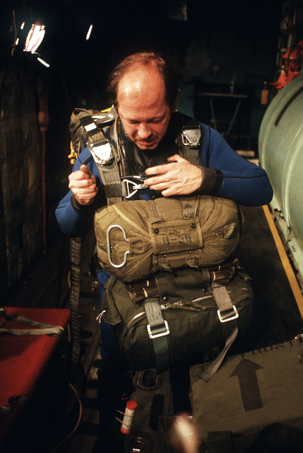 TSGT Wilkenson, a pararescueman with the 129th Aerospace Rescue and Recovery Group of the Air National Guard, makes a final check of his equipment prior to a practice rescue mission in the open ocean