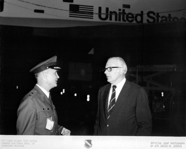 Secretary of the Air Force John C. Stetson discusses the NASA space shuttle orbiter Enterprise with Major General Thomas P. Stafford, Commander of the Air Force Flight Test Center