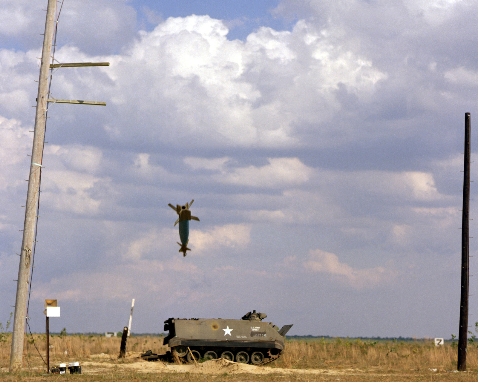 An inert Mark 84 (GBU-10) laser guided bomb homes in on an ...