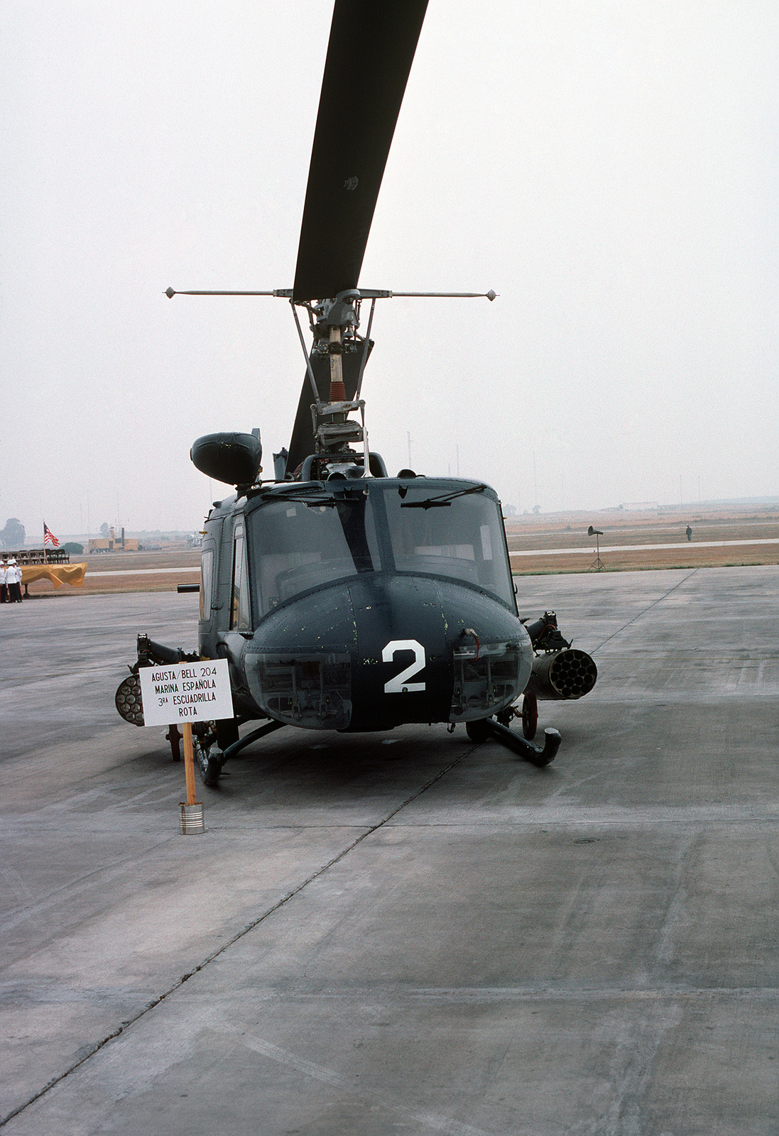 A front view of a Spanish navy Agusta-Bell 204AS helicopter parked on the flight line