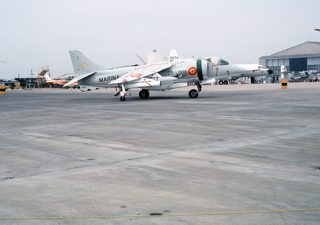 A right side view of a Spanish navy AV-8S Matador aircraft parked on the flight line