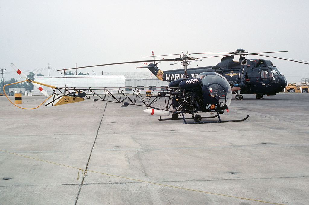 A right side view of a Spanish navy Bell H-13 Sioux parked on the flight line