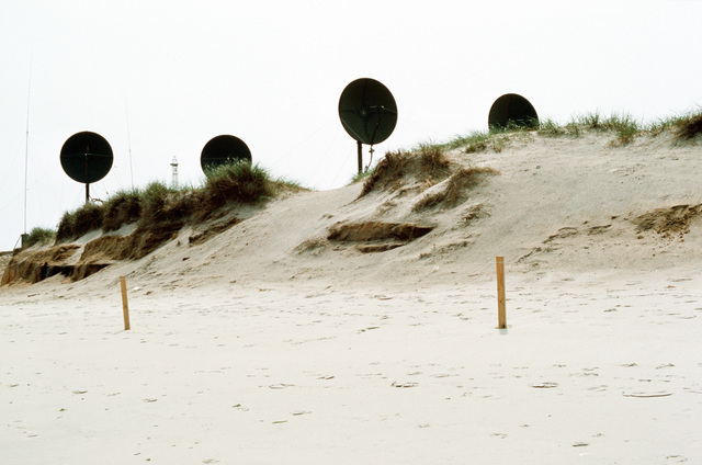 A TRC-97 communications antenna installation on the beach during joint readiness training exercise SOLID SHIELD '77
