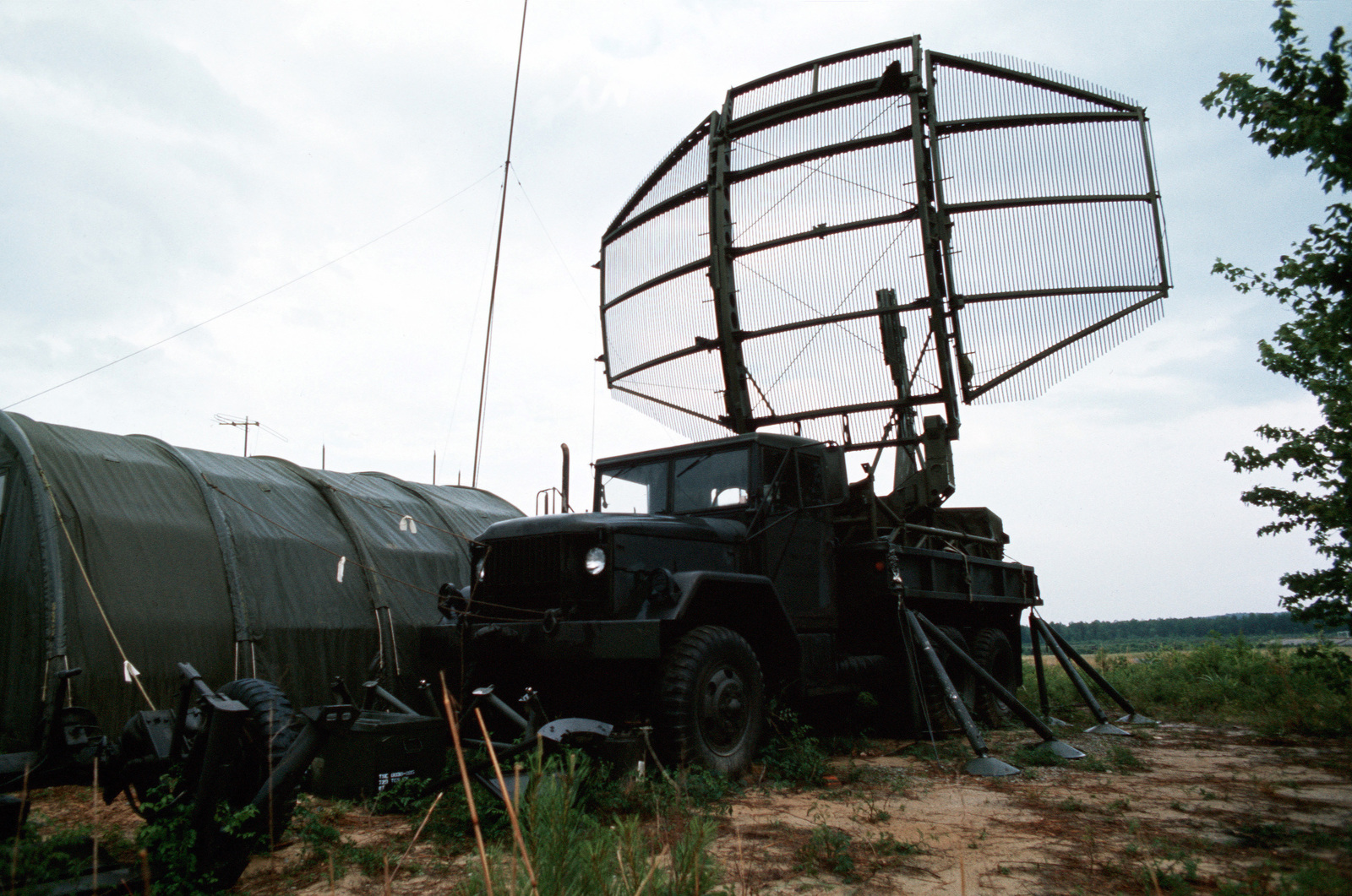 A truck-mounted AN/TPS-43 tactical 3-D radar antenna in use during joint readiness training exercise SOLID SHIELD '77
