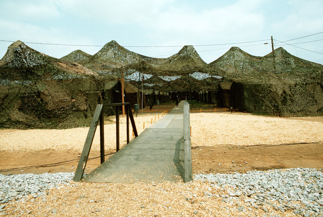 A view of a camouflaged tent complex in use during joint readiness training exercise SOLID SHIELD '77