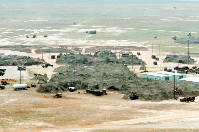 An aerial view of camouflaged installation in use during joint readiness training exercise SOLID SHIELD '77