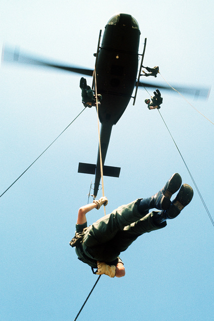 Infantrymen rappel from a UH-1 Iroquois helicopter during field training exercises