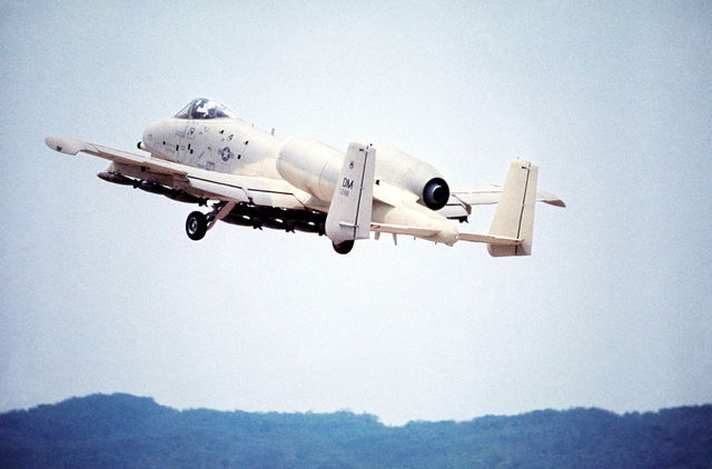 A left rear view of an A-10 Thunderbolt II aircraft taking off with a full load of Mark 82 Snake Eye bombs attached to the undercarriage. The A-10, assigned to the 355th Tactical Fighter Wing, is on a demonstration tour of air bases in Korea to familiarize field commanders with its capabilities