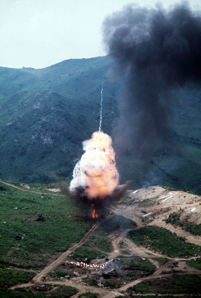 A missile fired from an A-10 Thunderbolt II aircraft explodes in the target area on Nightmare Range during Exercise COPE STRIKE X-RAY. The A-10 is on a demonstration tour of air bases in Korea to familiarize Korean and American field commanders with its capabilities