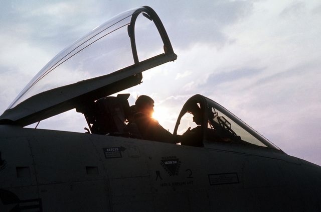 An A-10 Thunderbolt II aircraft pilot, assigned to the 355th Tactical Fighter Wing, prepares to climb out of his aircraft after flying a late afternoon mission. The aircraft is on a tour of air bases in Korea to familiarize Korean and American field commanders with its capabilities