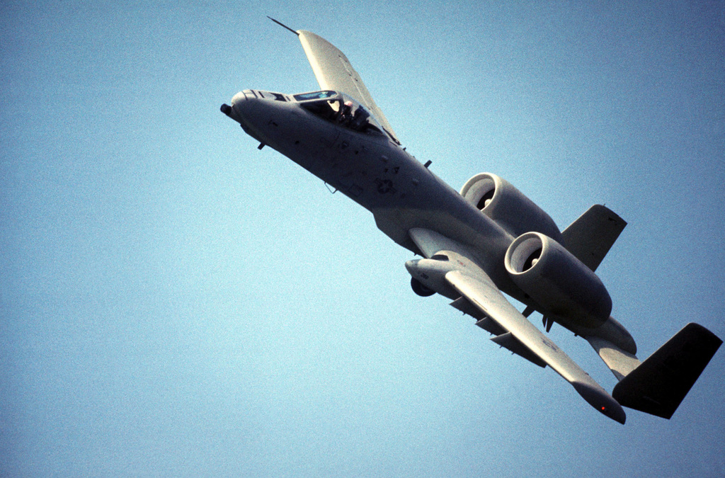 An air-to-air left front view of an A-10 Thunderbolt II aircraft maneuvering during a demonstration tour of air bases in Korea to familiarize Korean and American field commanders with its capabilities