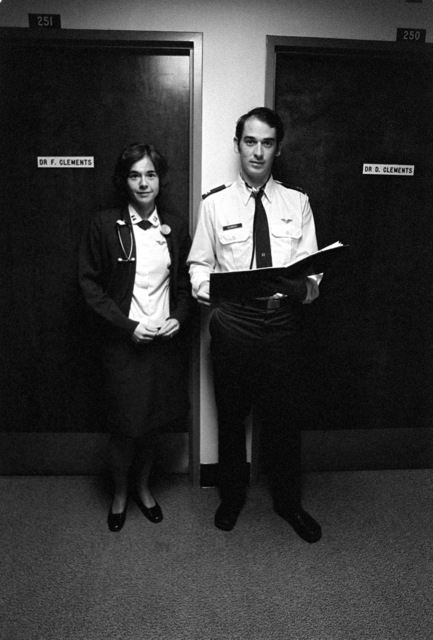 Fiona and Dennis Clements, both captains assigned to the Norton Air Force Base Medical Clinic, stand in front of their adjoining offices. They are the only husband and wife flight surgeons in the Air Force. Fiona Clements is the only female flight surgeon in the Air Force