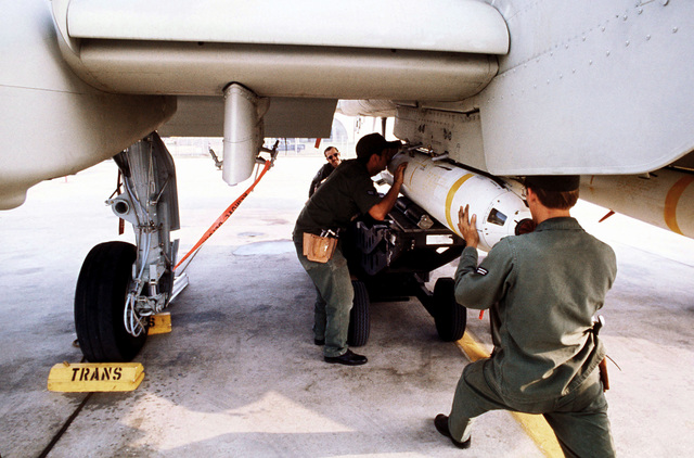Ground crewman attach a live Mark 20 anti-tank cluster bomb to the wing pylon of an A-10 Thunderbolt II aircraft. The A-10, from the 355th Tactical Fighter Wing, is on a demonstration tour of air bases in Korea to familiarize Korean and American field commanders with its capabilities