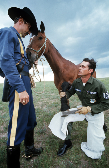 Technical Sergeant Dave Weissinger, a missile technician, does some horse-shoe work for the 5th Cavalry reorganized