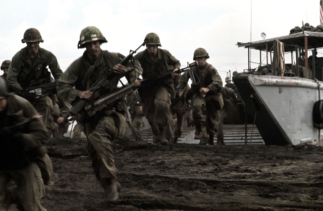 US Army Troops disembark from a landing craft for a beach assault against the 4th Battalion, 10th Infantry, during an Army Training and Evaluation Program (ARTEP)