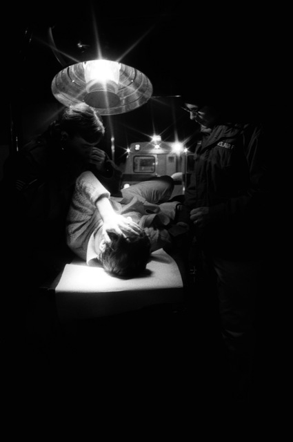 SSGT Tony Ware, left, and SSGT Johnathan Hussey treat a patient in the emergency room of the USAF hospital