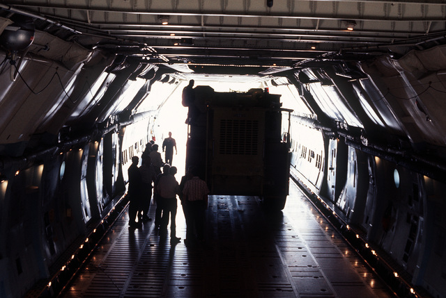 A view of a U.S. Air Force P-15 fire truck prototype in the cargo hold of a C-5 Galaxy aircraft from the Military Airlift Command. The fire truck is being tested to see if it can be airlifted by the C-5