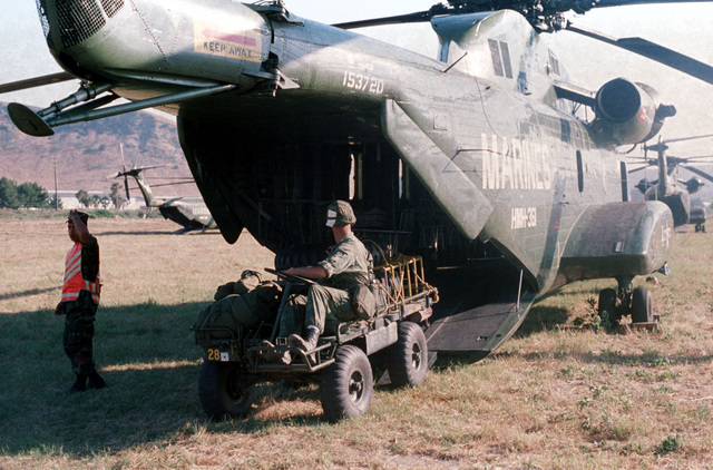 A Marine CH-53 Sea Stallion helicopter serves as a vehicle transport during exercise Brave Shield XVI