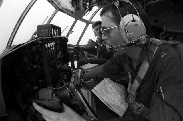 CPT Dikki Stanley of the 54th Weather Reconnaissance Squadron pilots a WC-130 Hercules aircraft through a typhoon in order to get first hand information on barometric pressure, wind strength, temperatures and directions. This information is relayed to meterorological specialists at the Joint Typhoon Warning Center