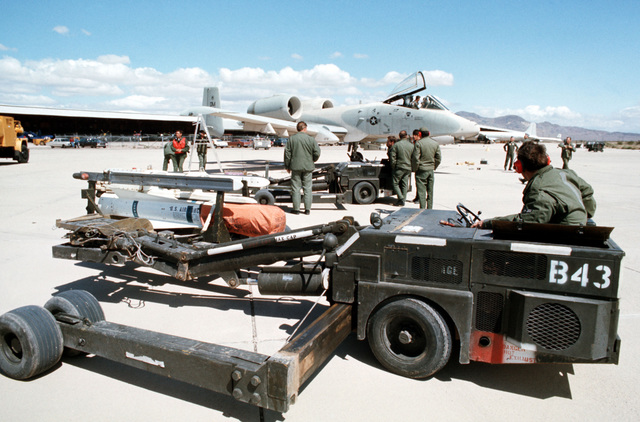Maintenance personnel stand by to re-load an A-10 Thunderbolt aircraft during a surge test, part of Operation Red Flag
