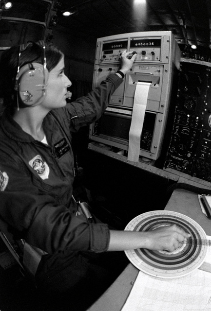 SGT. Debbie Whitacre uses a computer to transcribe, record and pass information that she received from a dropsonde sensor dropped by parachute from a WC-130 Hercules aircraft. The dropsonde is used to monitor a typhoon's direction so that the information can be promptly relayed to the Joint Typhoon Warning Center (JTWC)
