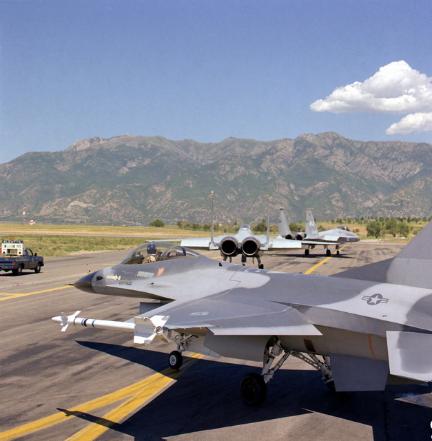 F-16 Fighting Falcon aircraft taxi out for a static demonstration. The last aircraft, foreground, is carrying one AIM-9J Sidewinder missile on each wing tip