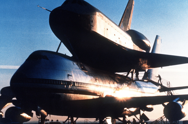 Space shuttle orbiter OV-101 Enterprise sits atop the fuselage of a specially modified Boeing 747 aircraft prior to a test flight
