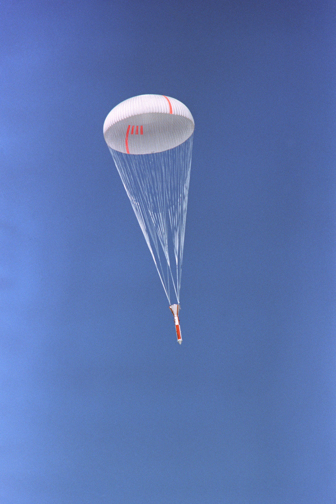 A view of the NASA Space Shuttle Program Solid Rocket Booster Deceleration Subsystem, as it approaches its impact point during a parachute drop test at the National Parachute Test Range
