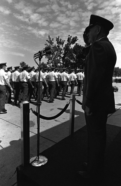 General Russell E. Dougherty reviews the troops for the last time during his change of command and retirement ceremony. Dougherty is being relieved by GEN Richard H. Ellis as commander in cheif of the Strategic Air Command