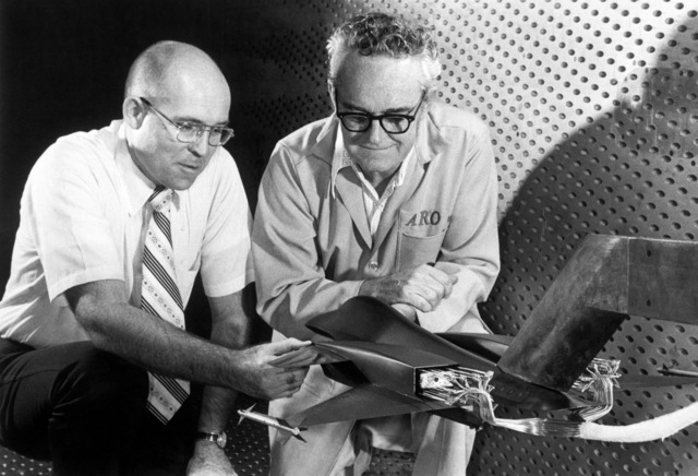 Jack Walker, a General Dynamics engineer, left, and Al Brooks, a test facility craftsman for ARO Inc., examine an advanced design concept of a fighter aircraft in the four-foot transonic wind tunnel at the Arnold Engineering Development Center