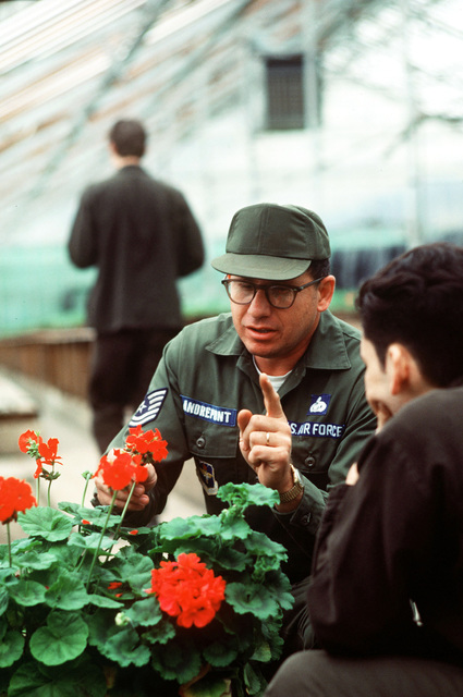 Technical Sergeant Bernard Andrepont helps an inmate study gardening techniques at the US Disiciplinary Barracks