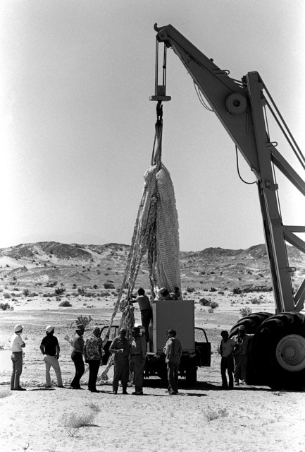 The parachute used for the NASA Space Shuttle Program Solid Rocket Booster Deceleration Subsystem is recovered, after a drop test at the National Parachute Test Range