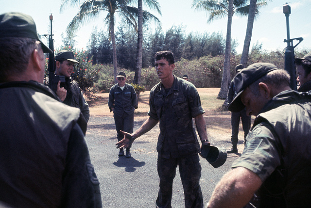 SSGT Richard Bishop, a Marine Corps instructor, critiques the performance of a group of Air Force security policemen who have just completed an anti-terrorist operation. The policemen are participating in an anti-terrorist exercise being conducted by the 1st Marine Brigade School