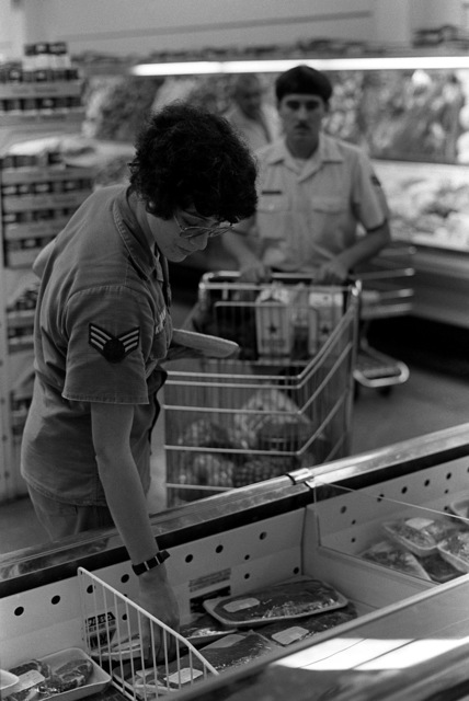 SRA Ella and SGT Allen Kirkham shop at the commissary after completing an exercise. They are part of the Base Engineering Emergency Force, Prime Beef