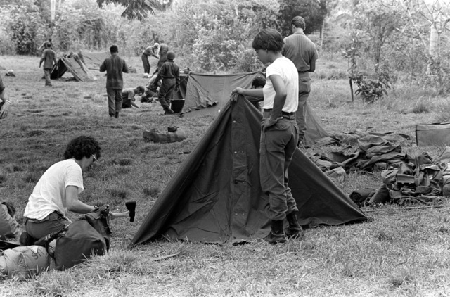 SRA Ella Kirkham, left, and a teammate, members of the Base Engineering Emergency Force, Prime Beef, set up their tent during an exercise