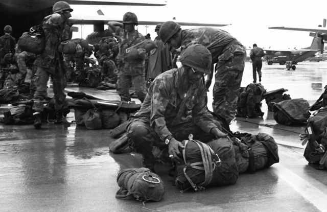 Troops of the 82nd Airborne Division prepare to board a Military Airlift Command C-130 Hercules aircraft. They will be airlifted to Fort Campbell, Kentucky, to participate in an airborne assault during combined Army and Air Force training exercise Neptune II