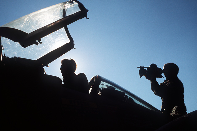 SSGT William Wood, an Air Force Audiovisual Service motion picture cameraman, films early morning maintenance being performed on an F-4 Phantom II aircraft. The F-4 from the 9th Tactical Fighter Squadron, has just completed a trans-Atlantic flight from Holloman Air Force Base, New Mexico to participate in exercise Crested Cap '77