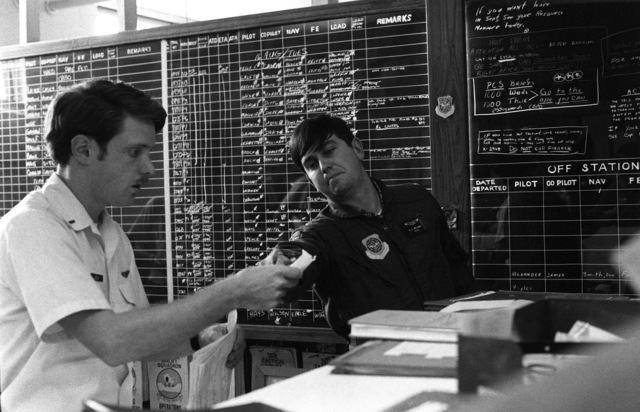 Information concerning air-drops by the 82nd Airborne Division is plotted on boards in a command center during Exercise NEPTUNE II