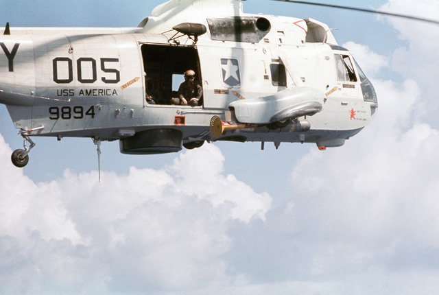 A close-up view of a Helicopter Anti-submarine Squadron 15 (HS-15) SH-3 Sea King helicopter conducting routine anti-submarine warfare exercises