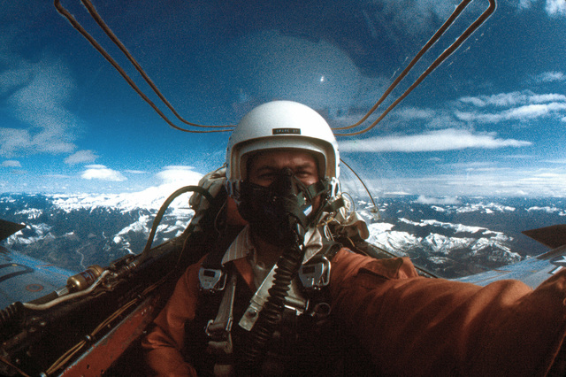 A cockpit view of a T-33 Shooting Star pilot on a return mission after photographing the return mission of seven F-106 Delta Dart aircraft from Tyndall Air Force Base, Florida. Mount Rainer is in the background
