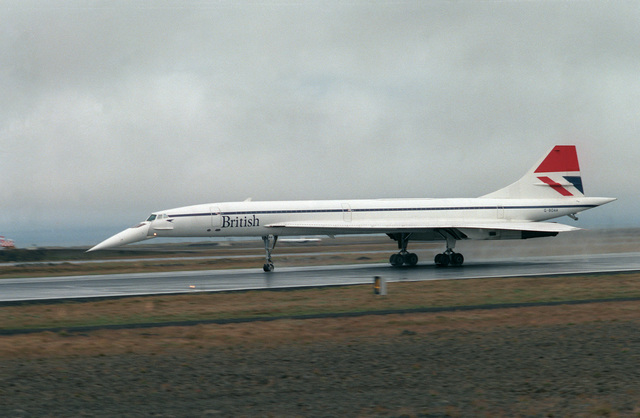 A left side view of a British Airways Concorde aircraft taxiing along the flight line.  The aircraft is on an around-the-world test flight