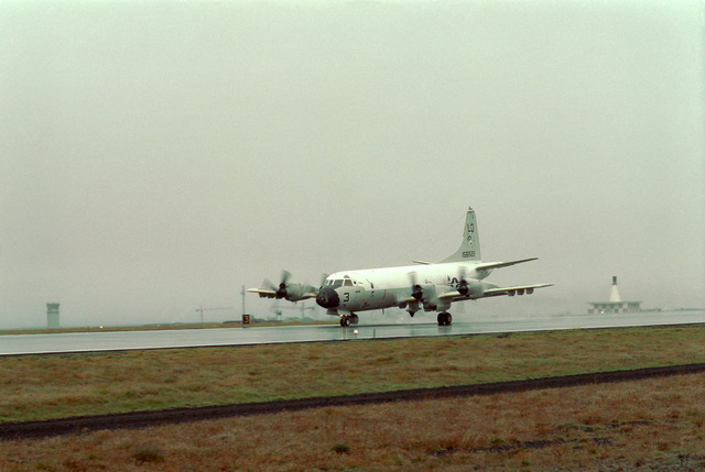 A Patrol Squadron 56 (VP-56) P-3 Orion aircraft taxis along the flight line