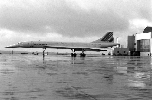 A left side view of an Air France Concorde supersonic passenger aircraft parked on the flight line during a stopover at the air station