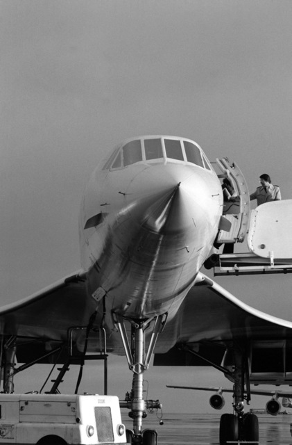 An Air France Concorde supersonic passenger aircraft is serviced on the flight line during a stopover at the air station