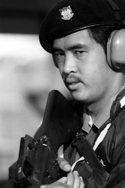 SGT Mario S. Rivera sights down the barrel of an M-16 rifle during an Air Force Marksmanship Meet