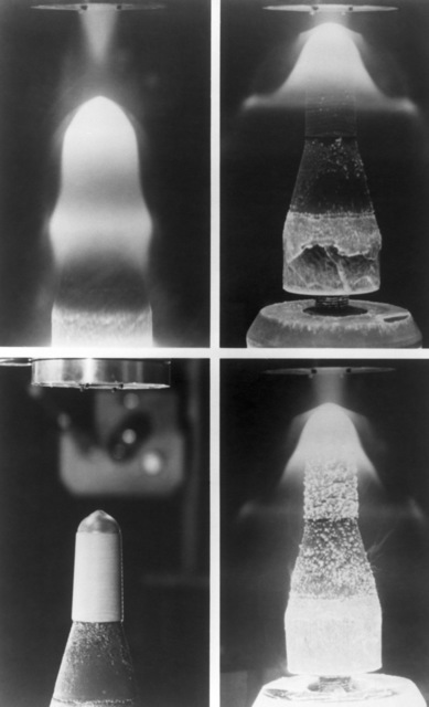 A composite photo of a water-cooled nose tip of a re-entry vehicle during a test in the re-entry test facility at the Arnold Engineering Development Center.  A stream of super-heated, high velocity air is being directed against the nose tip