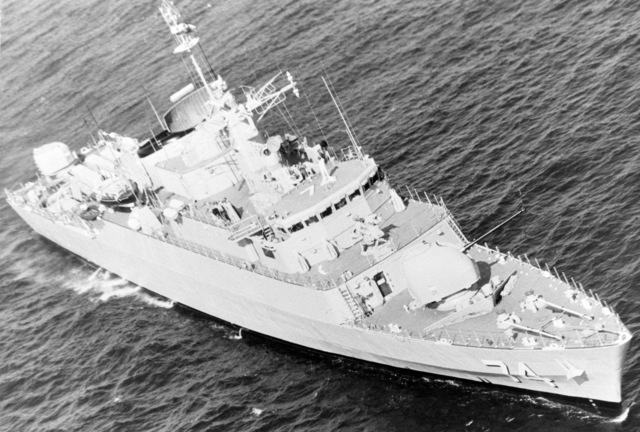 A starboard bow view of the Iranian destroyer escort ITS FARAMARZ (DE 74), now redesignated the frigate IS SAHAND (F 74). NOTE: This vessel was sunk on 19 April 1988 by aircraft CVW 11 from the aircraft carrier USS ENTERPRISE (CVN 65) in retaliation for the mining of the USS SAMUEL B. ROBERTS (FFG 58) in the Persian Gulf. The vessel was hit by three Harpoon missiles and numerous cluster bomblets