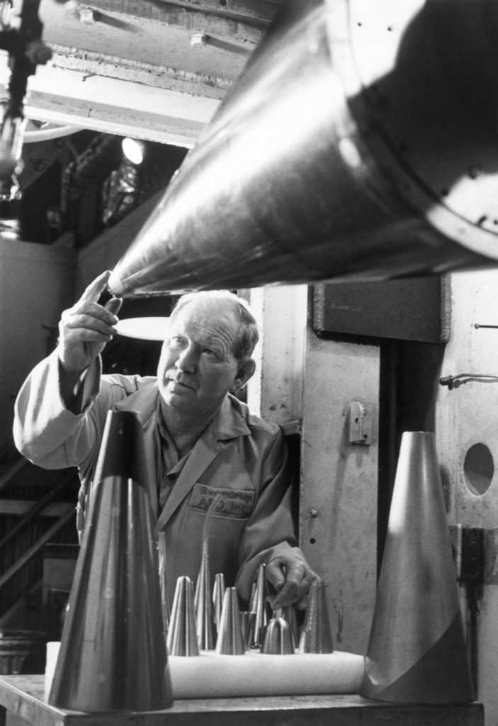 John Land, an ARO Inc. test facility craftsman, examines the nose tip of a simulated re-entry vehicle prior to a wind tunnel test at the Arnold Engineering Development Center