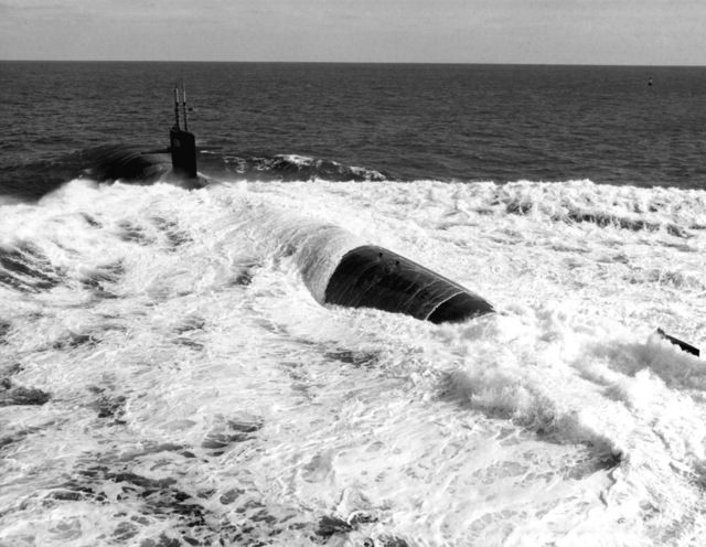 Aerial port quarter view of the nuclear-powered attack submarine USS MEMPHIS (SSN-691) underway