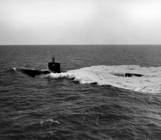 Aerial port view of the nuclear-powered attack submarine USS MEMPHIS (SSN 691) underway